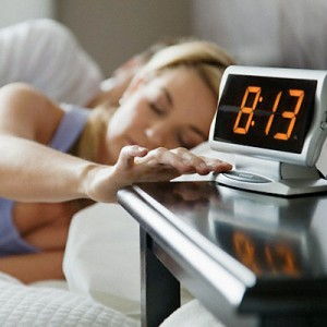 """""""woman hitting snooze button"""""""